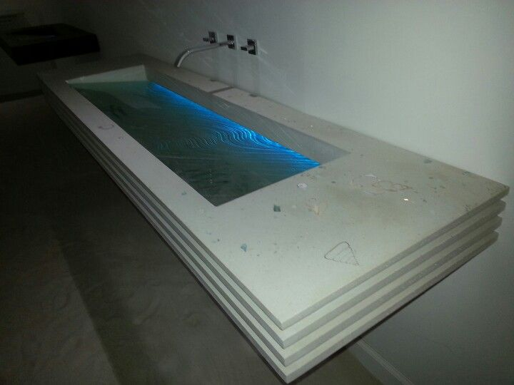 Gallery One Beautiful showroom surf sink Concrete and glass fusion bathroom vanity