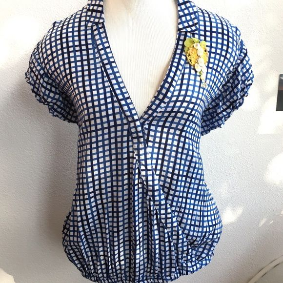 Blue Picnic checked/plaid blouse by Postmark I love this gorgeous blouse! Elastic hem, single snap button closure on the crossover front, and princess sleeves. Rayon blend, very soft! Looks so cute with shorts or even better with jeans and layered with a long sleeve tee underneath! Excellent condition! Anthropologie Tops Blouses