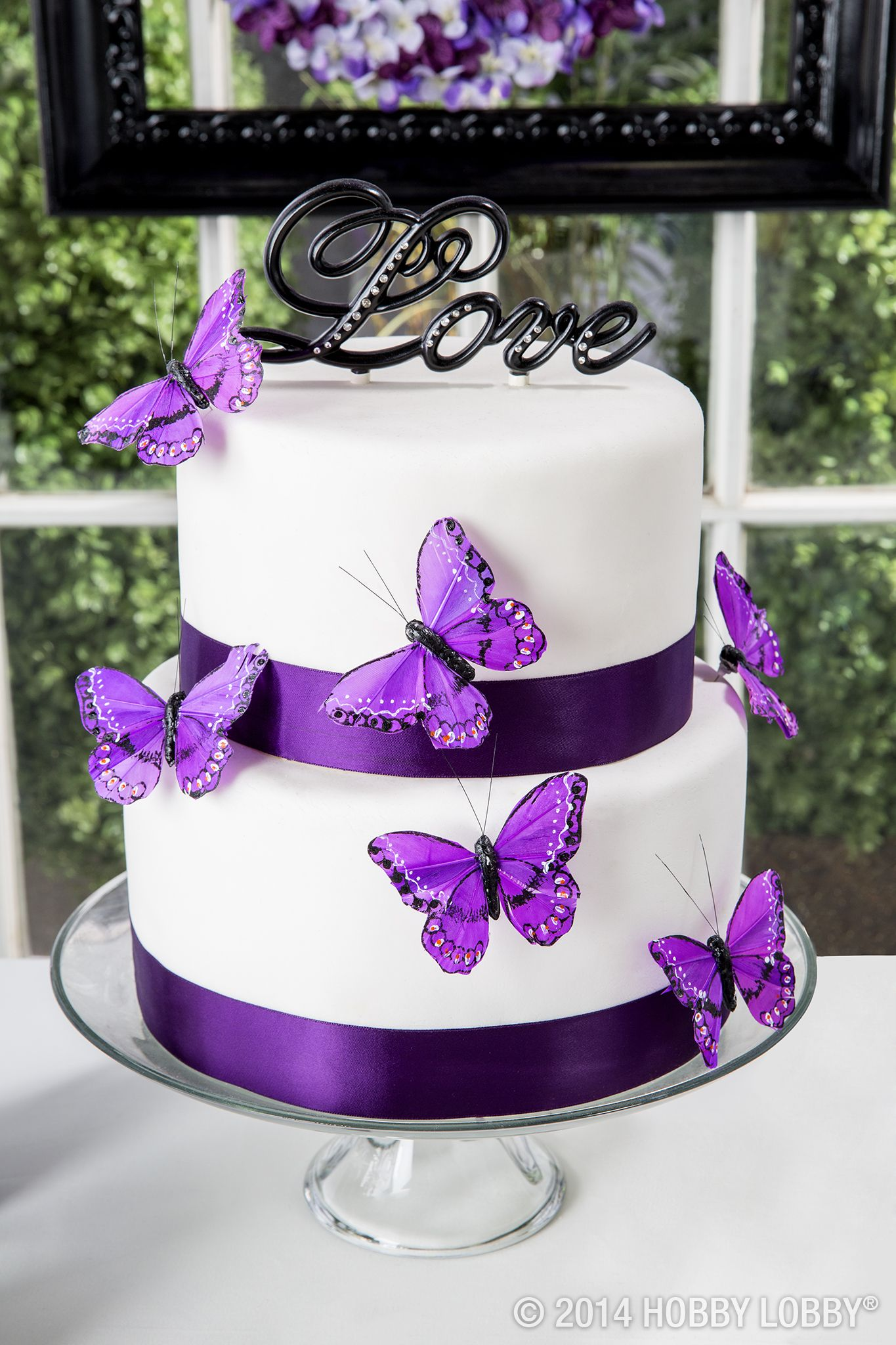 this white and purple wedding cake is topped off with a little love diy wedding ideas. Black Bedroom Furniture Sets. Home Design Ideas