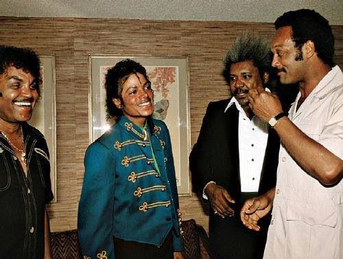 Michael Jackson with his father, Joe, promoter Don King and the Rev. Jesse Jackson.