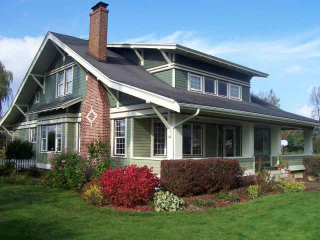 1915 Craftsman bungalow with green deep red paint scheme Garden
