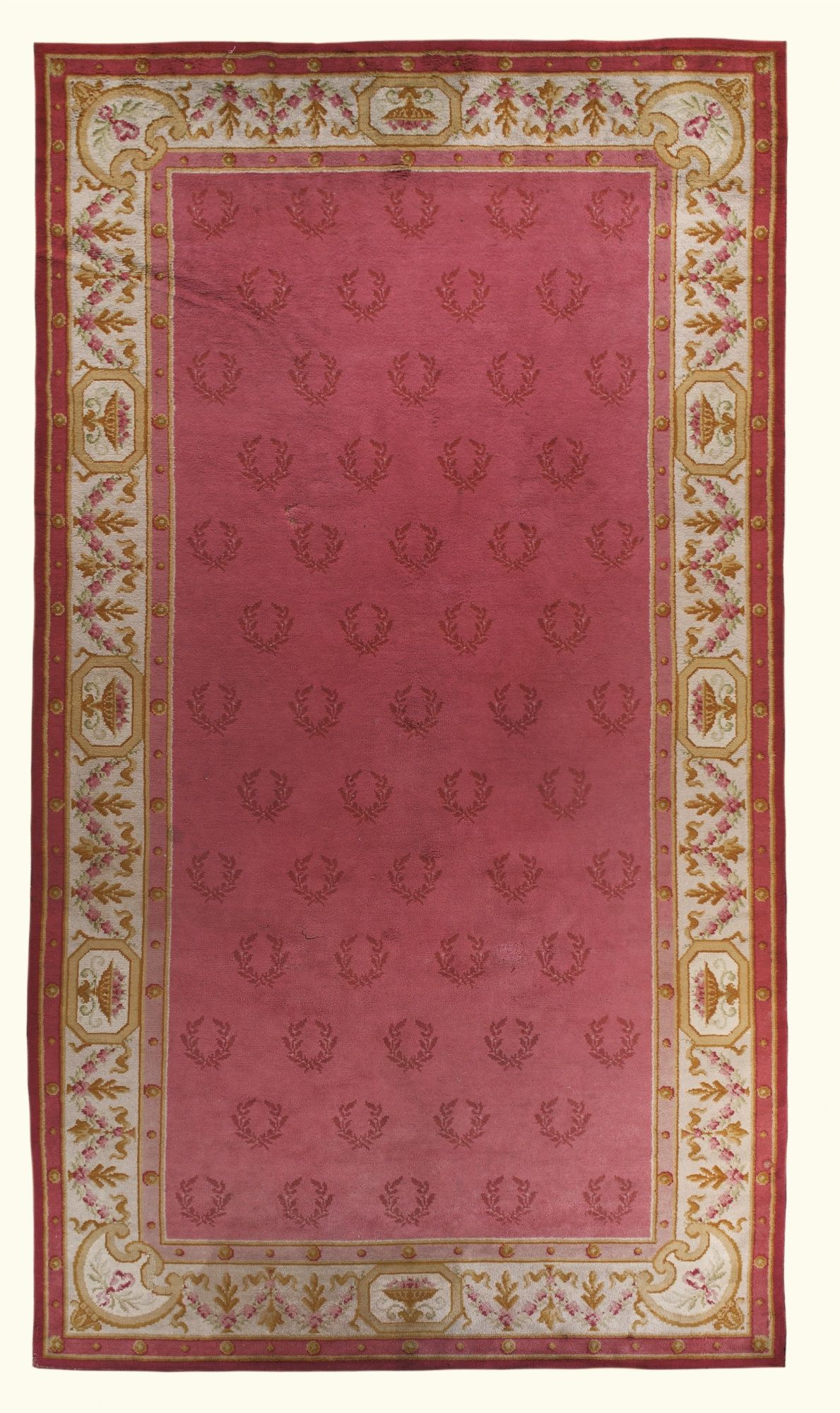 A Neoclical Style Carpet With Salmon Coloured Main Field Overall Repeat Pattern Of Crescent Shaped Motif Crossed Laurel Sprigs An Ivory