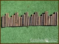 Black Bamboo Border. Bamboo borders are perfect accent pieces for flowerbeds, edging and a variety of other outdoor landscaping uses. Connected with hidden heavy gage stainless steel coated wire, they are sturdy, environmentally-friendly, and made to last.