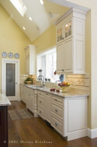 Gorgeous White Kitchen With Yellow Walls And Vaulted