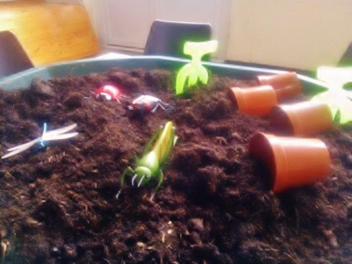 messy dirt play with plastic bugs, spades and flower pots! (thanks to Brownhills Messy Church, UK)