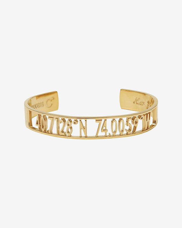 Coordinates Collection Cut Out Open Air New York Cuff: A 1/4 wide cut out band with an open underside slips on and perfectly presents directional coordinates for NY. In brass. Made in ...