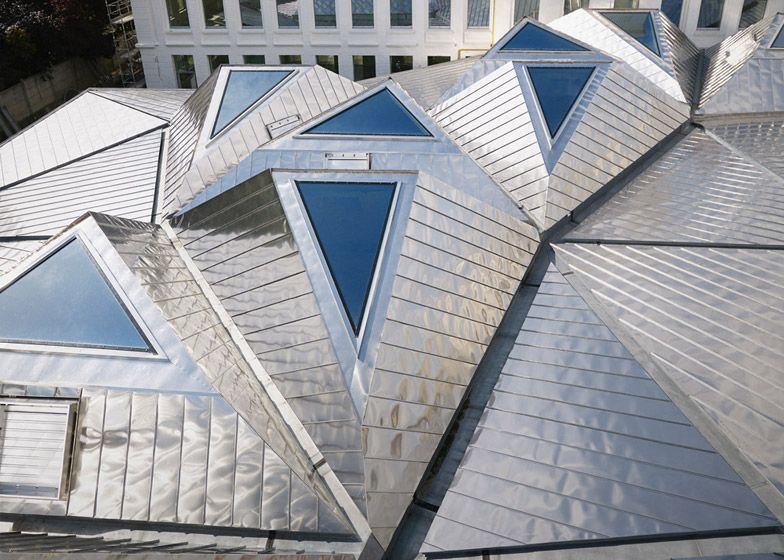 Triangular Skylights Set Into A Faceted Stainless Steel
