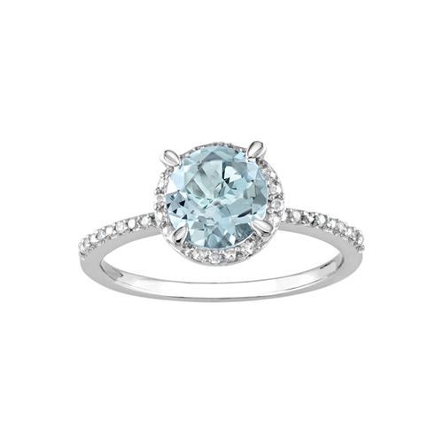 Online Exclusive! This marvelous ring features a 7mm round aquamarine gemstone set in sterling silver with round diamond accents. Show her how much she means to you with the gift of this fantastic ring! Band width is 1.5 mm.