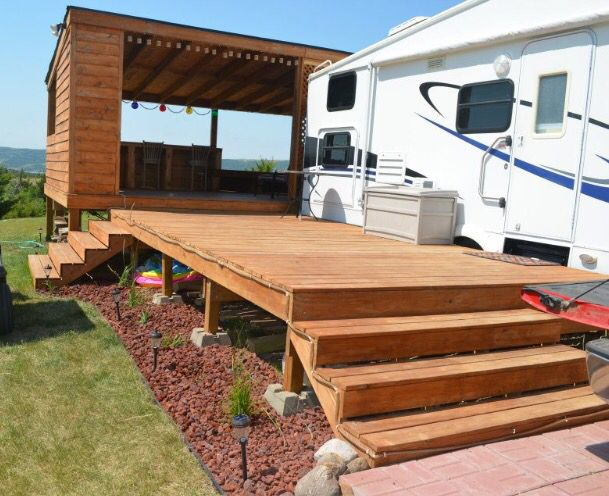 Deck we built always evolving at our permanent camp for Rv decks