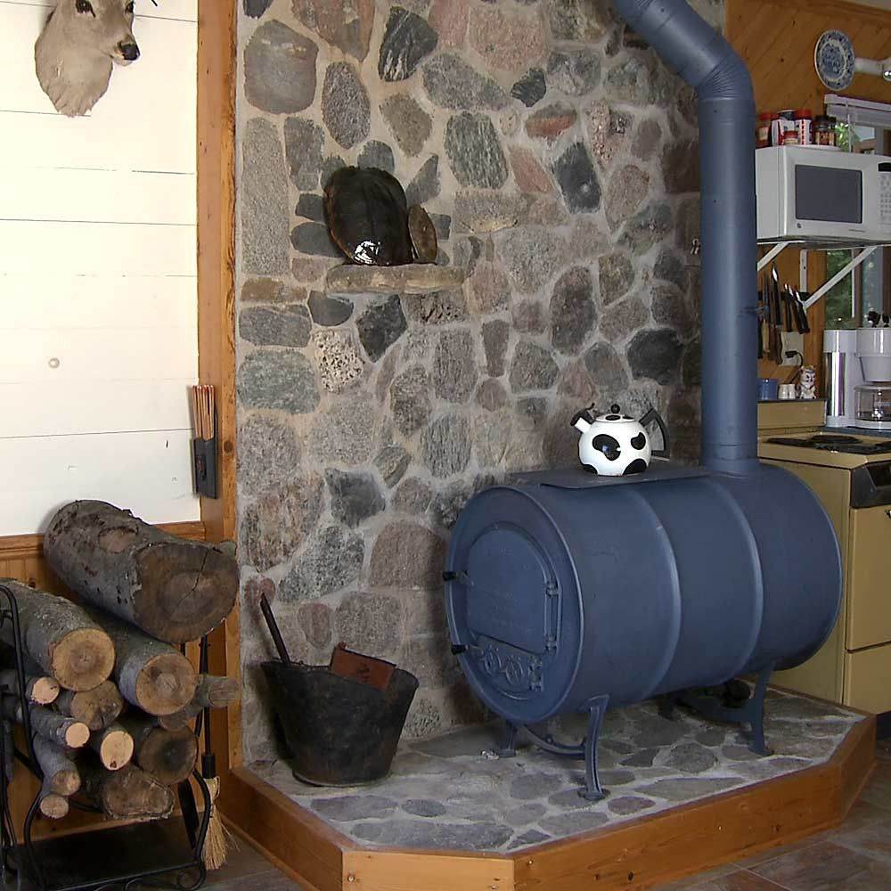 Vogelzang Deluxe Airtight Barrel Wood Stove Kit - Vertical Corner Hearth Made Of River Rock For Wood Stove