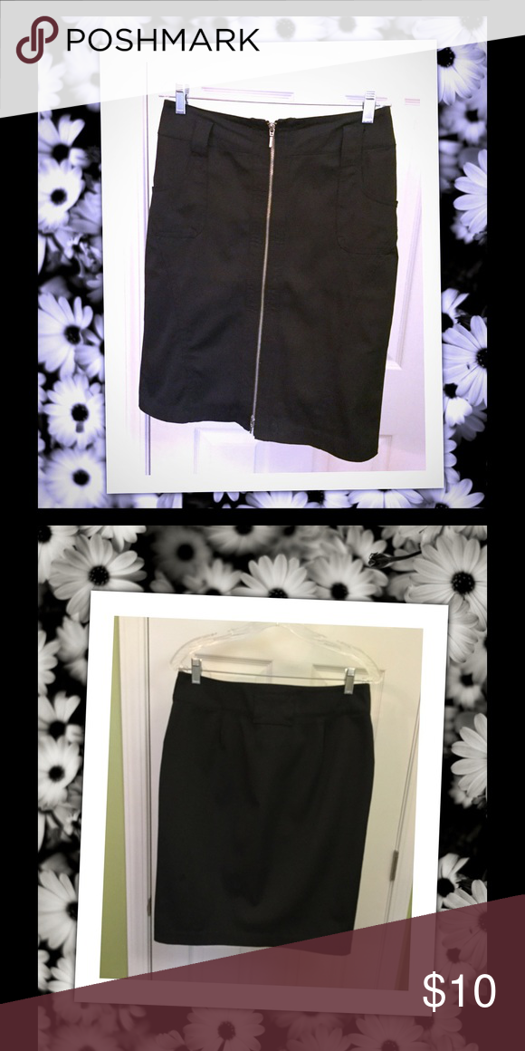 Zip Up Skirt This black skirt is really cool. Zipper works all the way up or down. Front pockets. Neat feeling material. Polyester, cotton and tiny bit of spandex. Dalia Collection Skirts Pencil