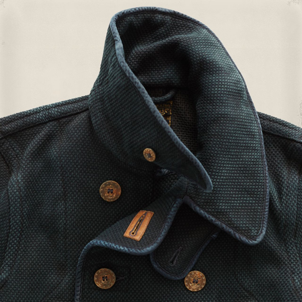 Limited-edition coat with details inspired by vintage Japanese firemen's jackets. Made from indigo-dyed basket-woven cotton that emula...