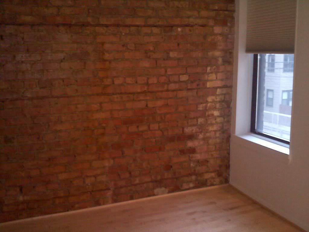 Faux red brick wall in master bedroom red brick walls