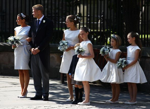 Best Man Iain Balshaw and the bridesmaids and flower girls depart from the Royal wedding of Zara Phillips and Mike Tindall at Canongate Kirk on July 30, 2011 in Edinburgh, Scotland. The Queen's granddaughter Zara Phillips will marry England rugby player Mike Tindall today at Canongate Kirk. Many royals are expected to attend including the Duke and Duchess of Cambridge.