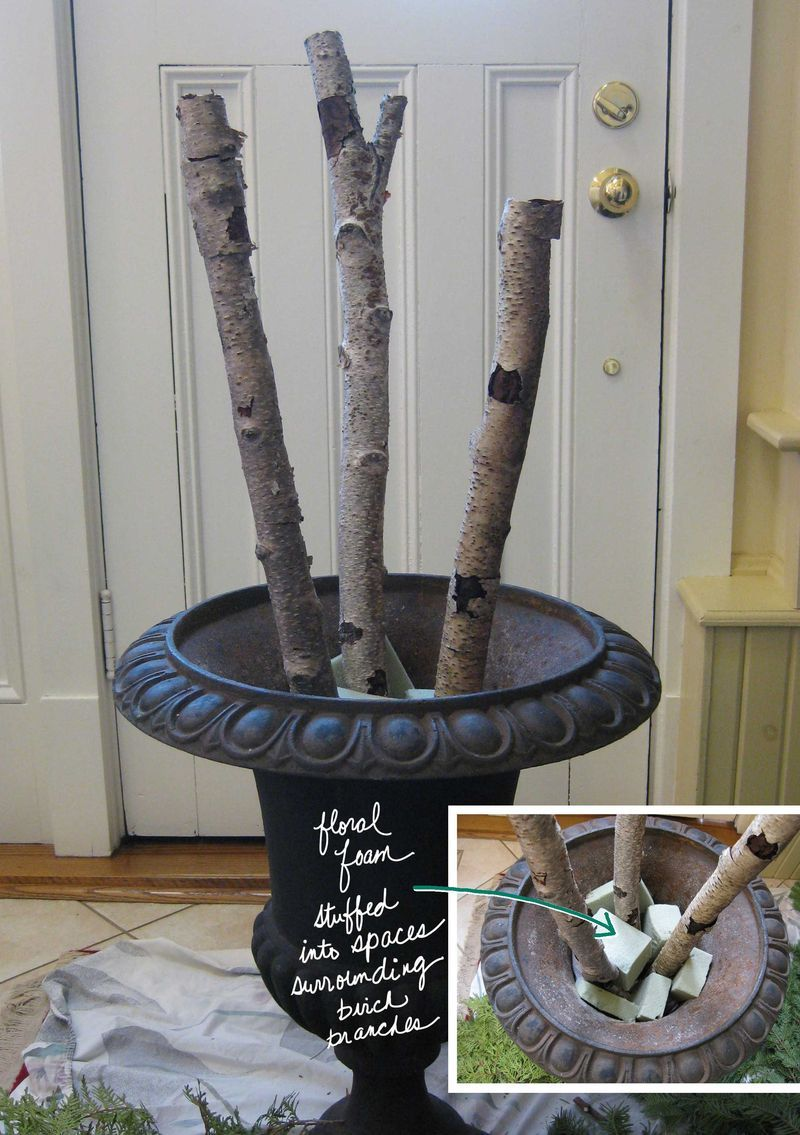 decorating tips for arranging branches and greens in a large outdoor urn christmas decor tips - Decorating Front Porch Urns For Christmas