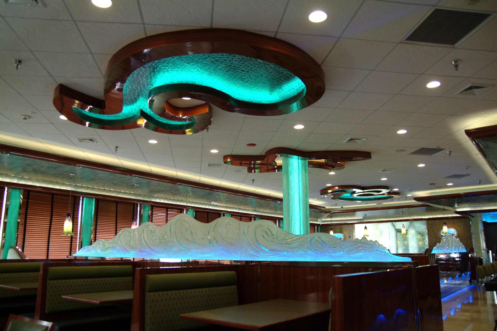 The Lit Sea Creature Shaped Ceiling Coves And Wave Glass Atop Half Walls Contribute To The Oceanic Experience Of The Ea Wave Glass Commercial Design Half Walls