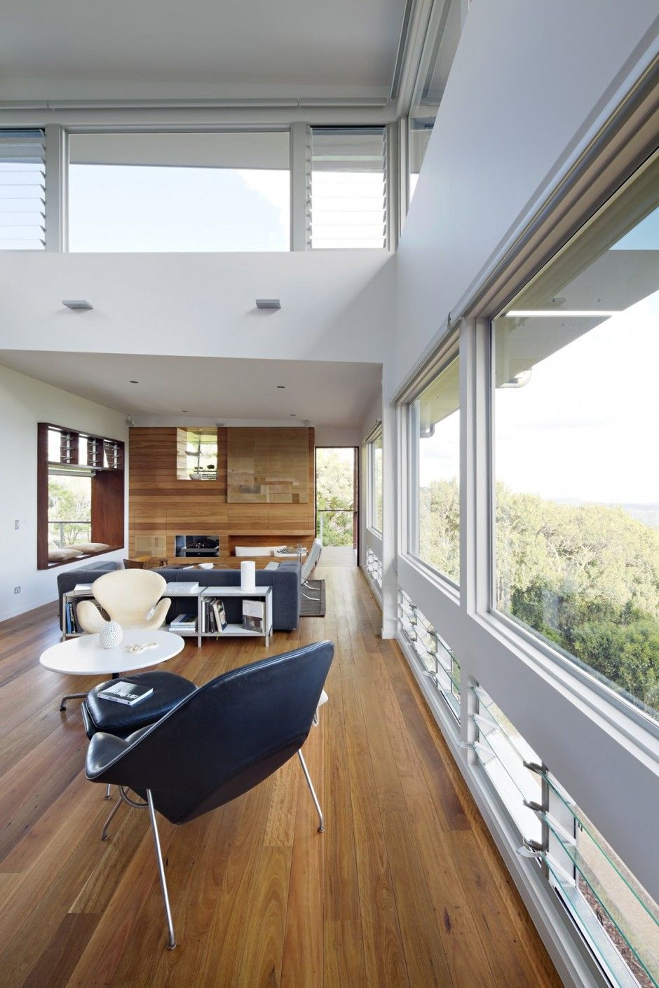 Not a tiny house. Nice uses of natural ventilation (low windows that open on one side of the house, high on the other) and wide overhangs that balance the huge amount of glass. This must be a very hot climate, no need for insulation from cold, with fabulous views.