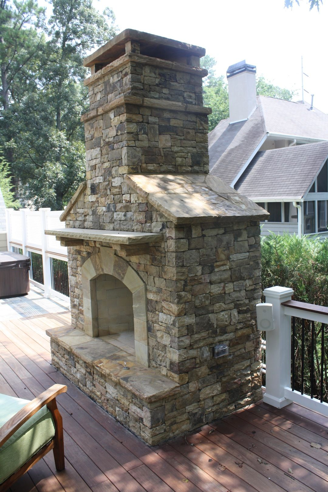 Outdoor Stacked Stone Fireplace With Hearth