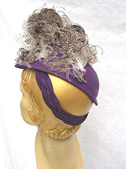 1930s 1940s purple tilt hat with asymmetrical feathers.