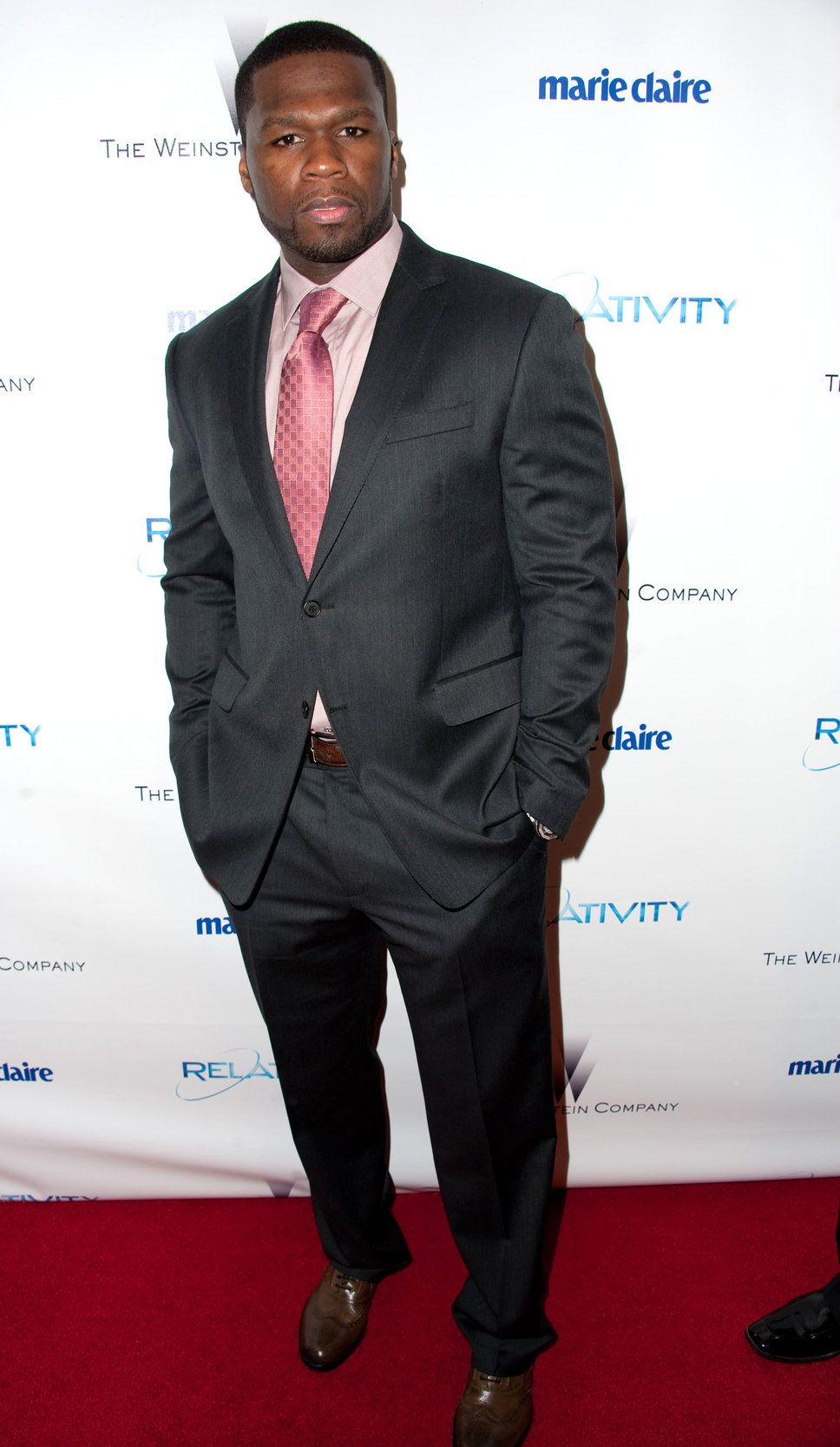 Curtis Jackson aka 50 Cent pink shirt pink tie dark grey suit ...