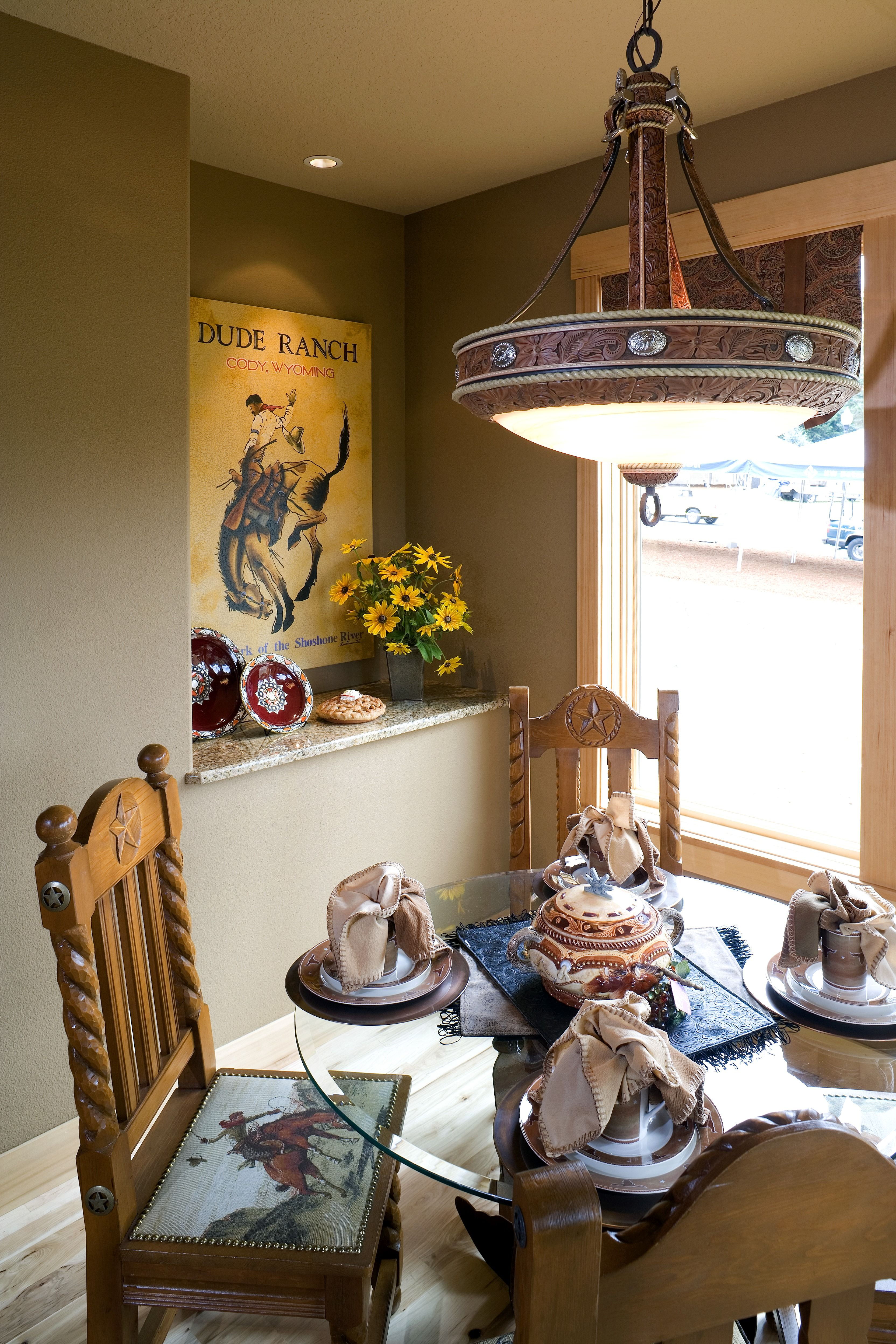 Casual And Comfortable Dining Room With An Intricate Detailed Chandelier Homeowners Certainly Love The Western Feel Rodeo Scene Seat Cushions