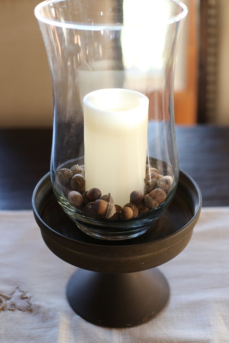 Fall decor acorn candle filler acorns around white candle make for