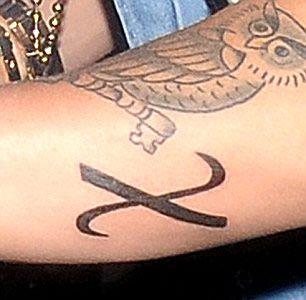 Justin Bieber S X Greek Christ Symbol Tattoo On His Arm Justin