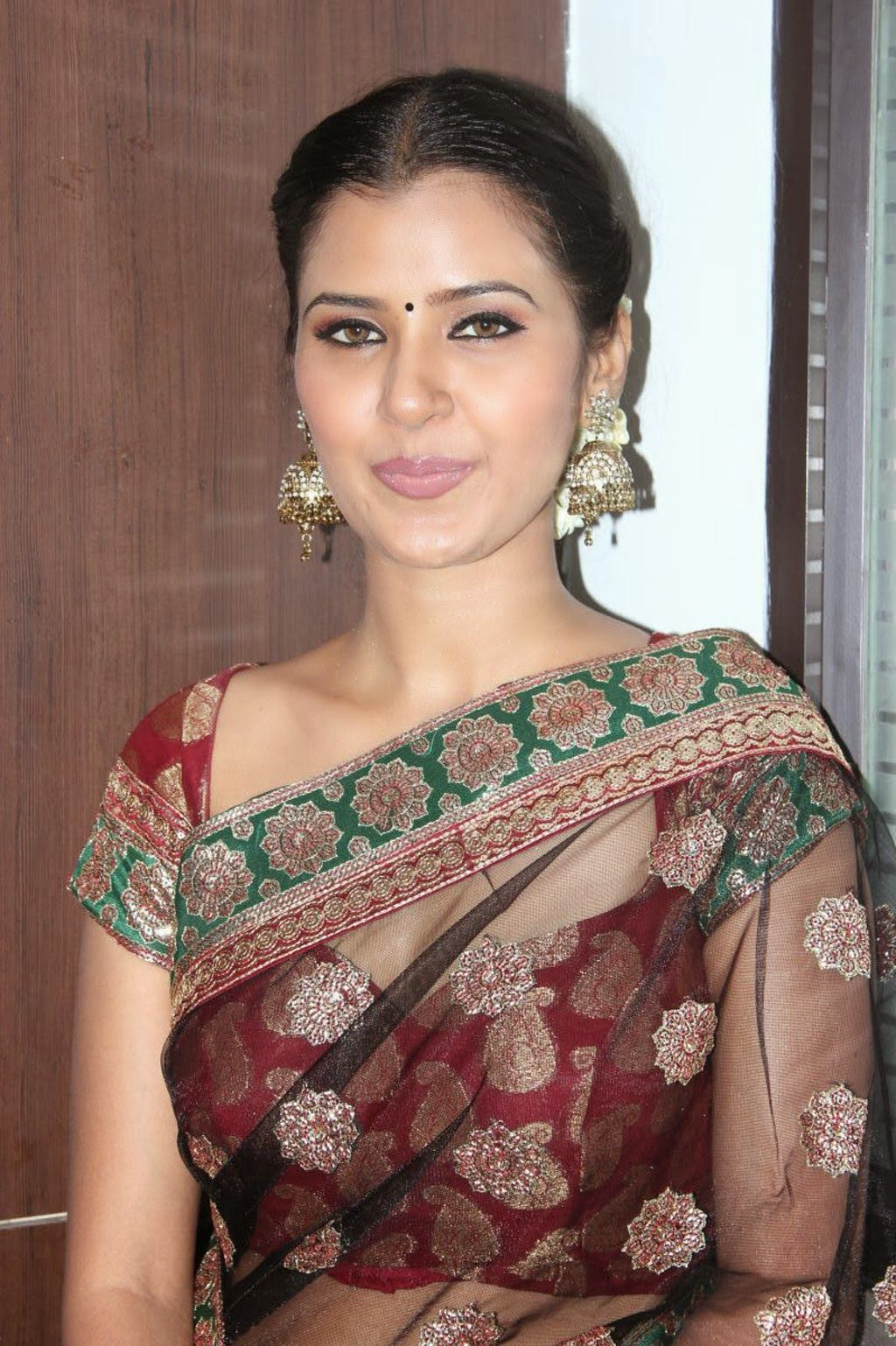 Jennifer Photos in Saree at Ravana Desam Audio Launch more @ http://luvcelebs.com