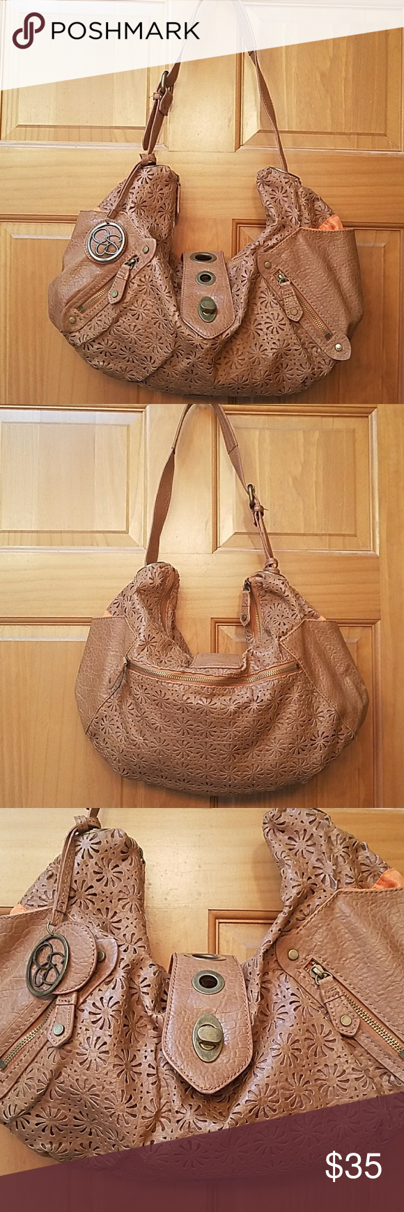Price reduced!! Jessica Simpson tan purse. Super soft material and so cute. Tan flower pattern and orange liner. Lots of pockets.  Offers welcome. Jessica Simpson Bags Shoulder Bags