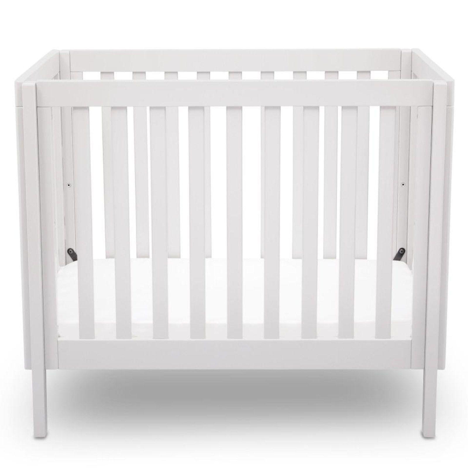 Delta Children Bennington Elite Mini Crib With Mattress  White