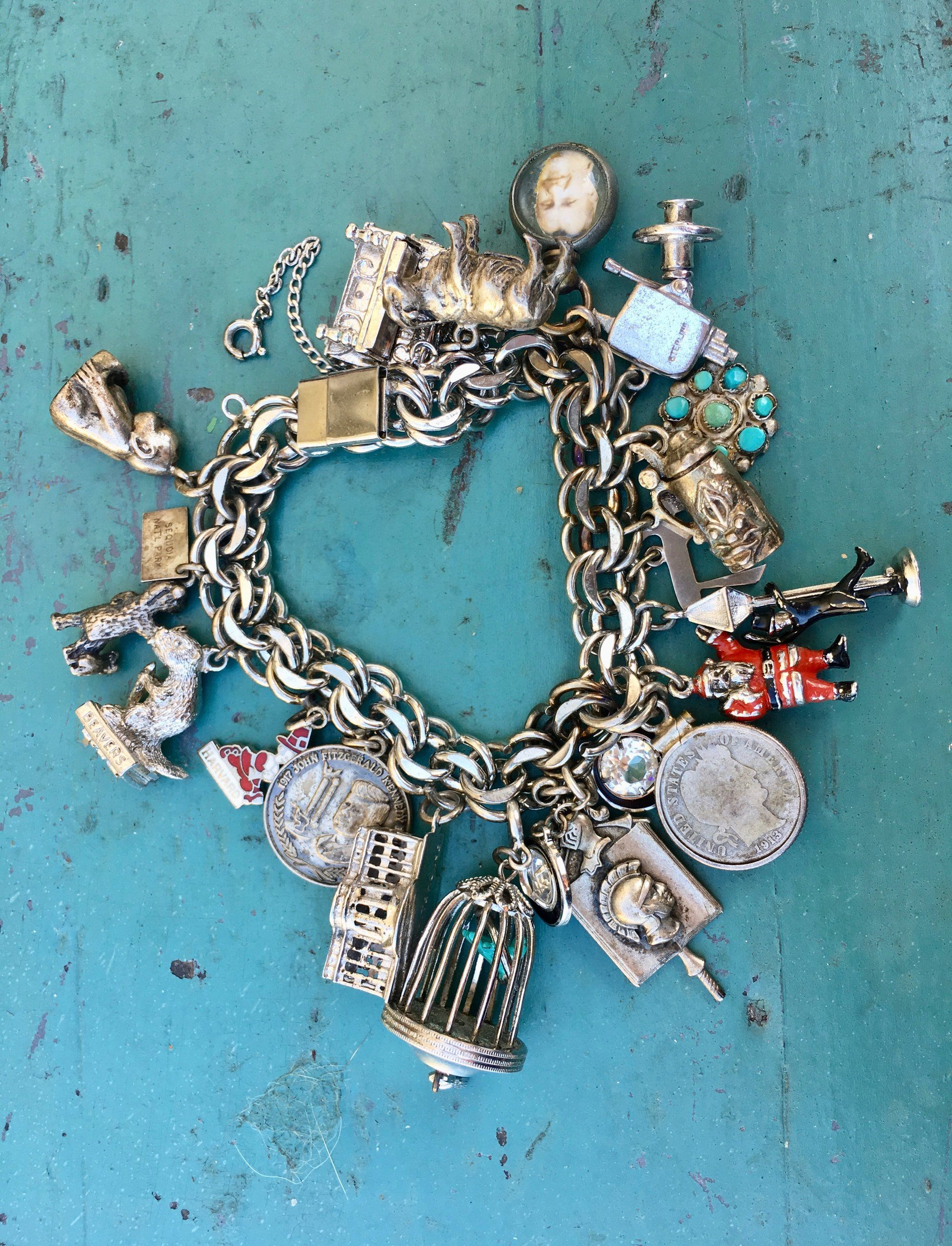 Heavy sterling silver bracelet loaded with 20 charms in