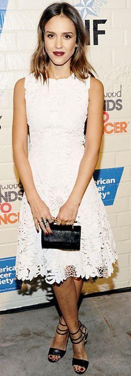 Who made  Jessica Alba's white lace dress, black clutch handbag, and jewelry?