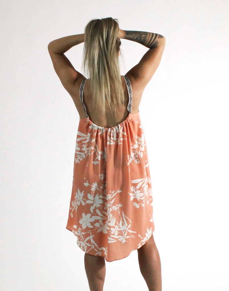 f6cc9cac0c You ll stay cool and look hot in this breezy coral sun dress featuring a  white floral print and embroidered straps.  rebellia  rebelbabe  dress   sundress