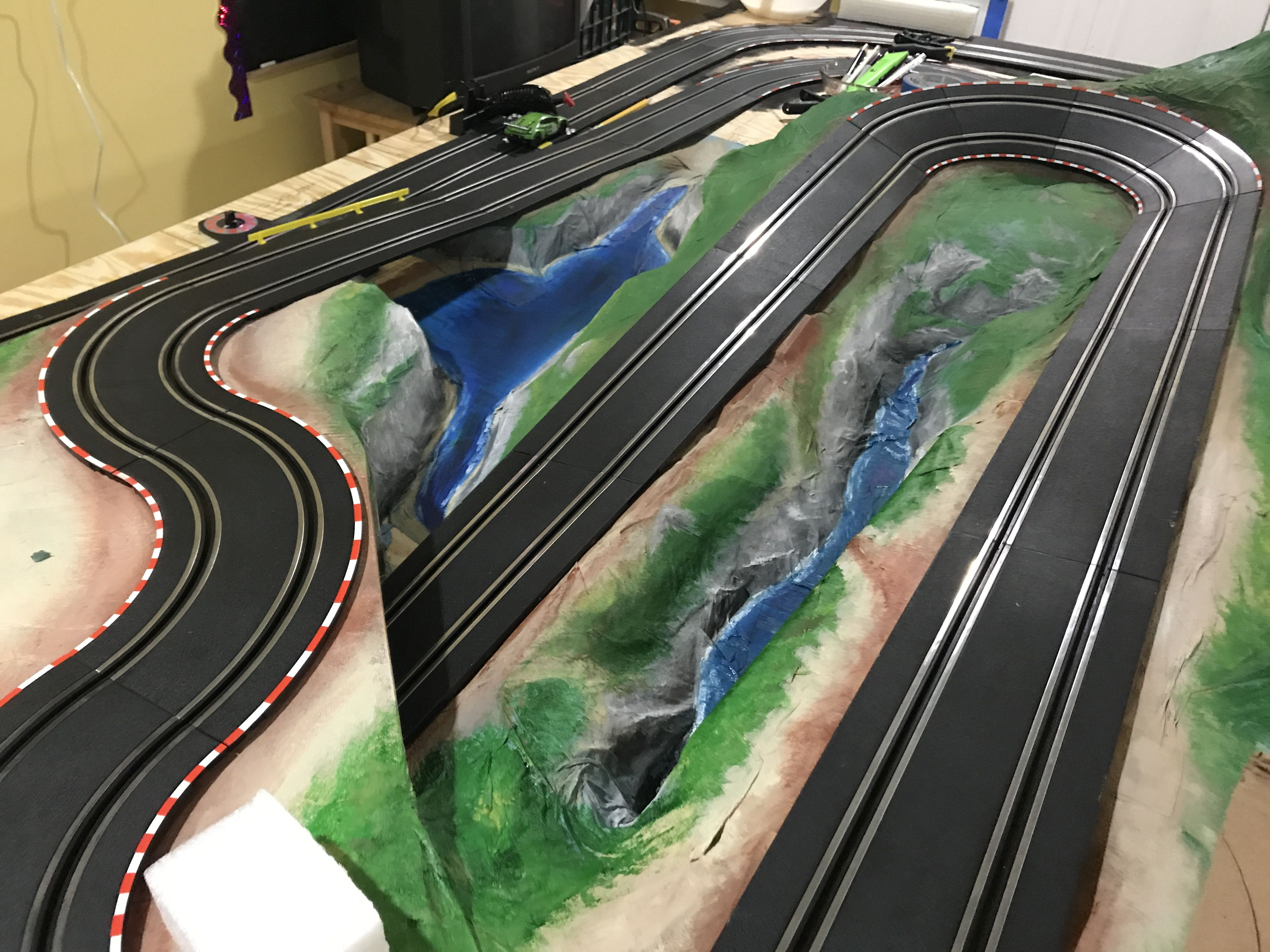 Landscaping is paper mache, painted. Slot cars, Slot car