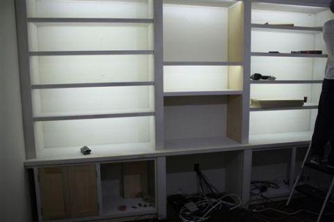 Bookshelves Lit With LED Reel/strip Lights