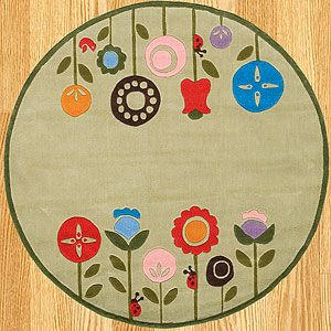 This is soo cute.  I want to find something like this with a black background.  Flower Garden Rug   World Market