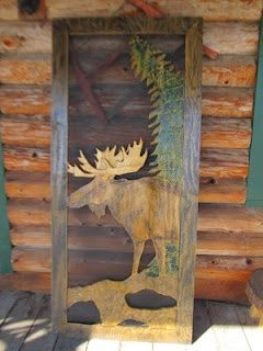 This Cabin Style screen door features a hand carved Moose ...