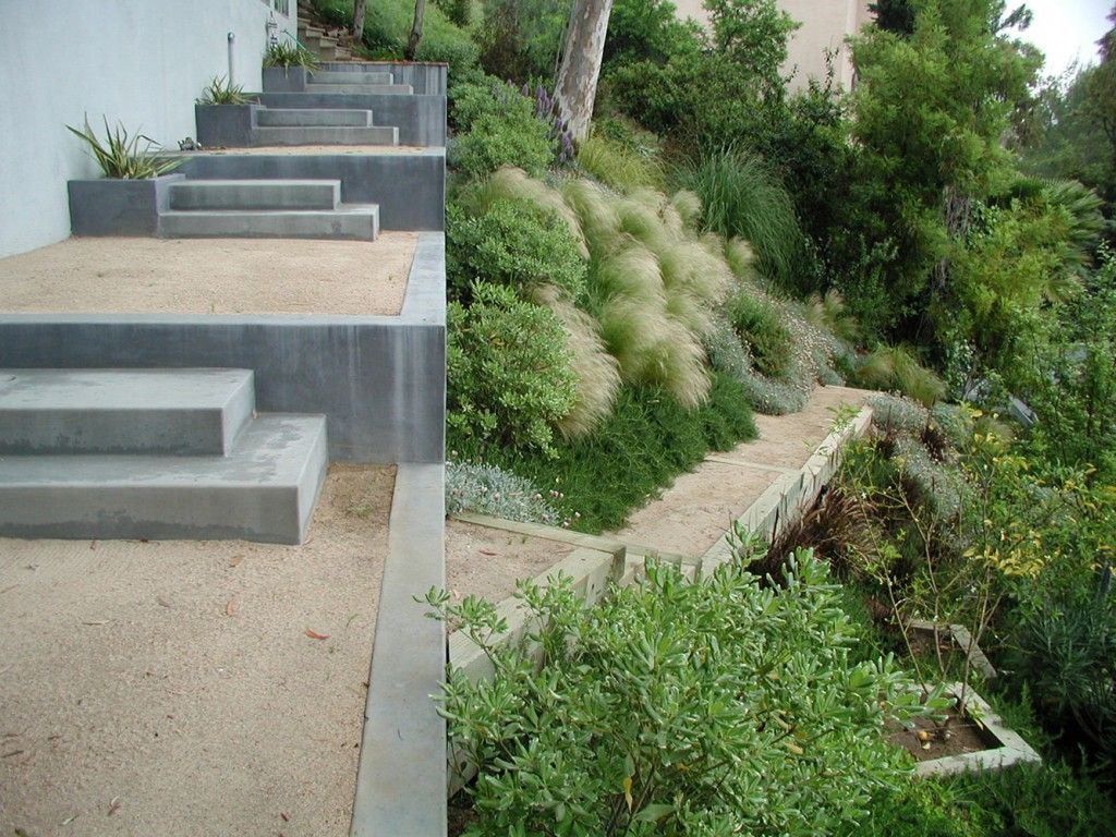 Concrete steps combined with crushed stone for a serous for Garden design hillside