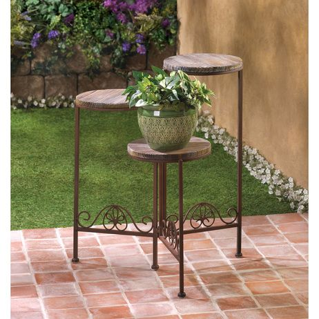 Rustic Triple Planter Stand hold three pots of flowers at various levels
