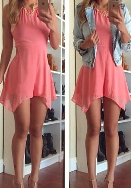 Double girl in a light coral halter romper taking a selfie