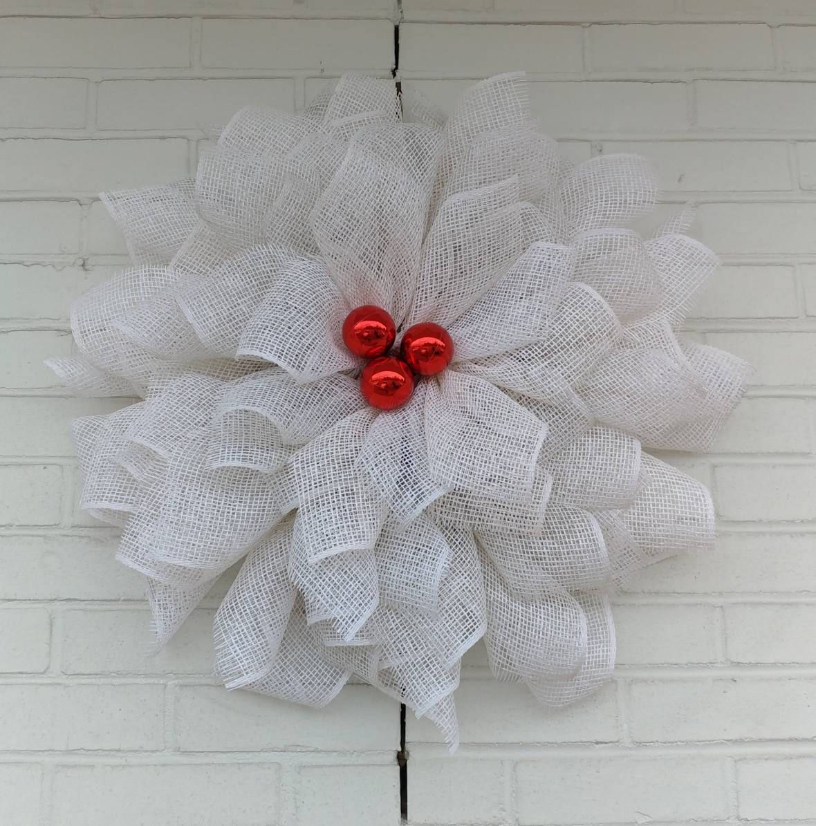 White Poinsettia Wreath with Shiny Red Christmas Ball