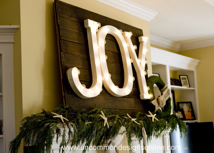 I used paper mache letters from JoAnn and umbrella lights from World Market to make them.  I will be back in a few days to show the complete tutorial.  It is so much easier than you would think!  They really worked out well hung on my stained pallet back drop, too.