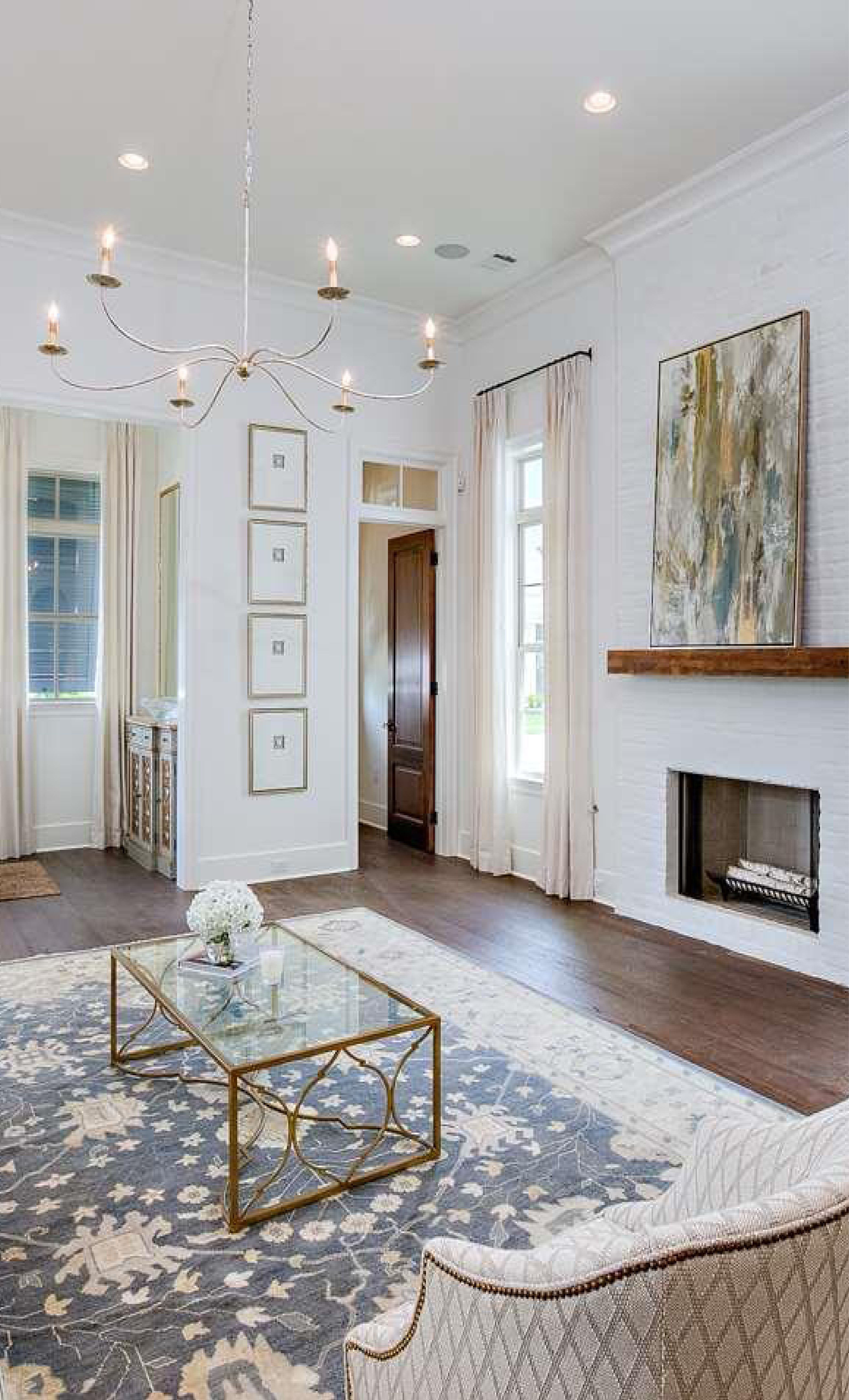 Spacious Formal Living Room With Painted White Brick Fireplace As