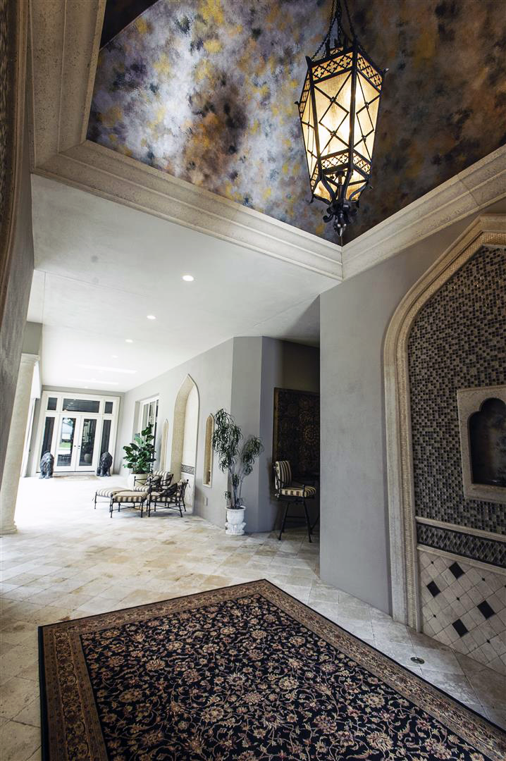 Gothic style exterior hallway with stunning architecture, ceiling mural and outdoor lighting fixture ~ Interior design by Howard Firth