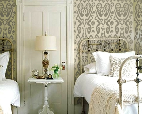 Victorian door meets country iron beds meets Ikat wall stencil meets Vintage clocks and look... they all play together nicely.
