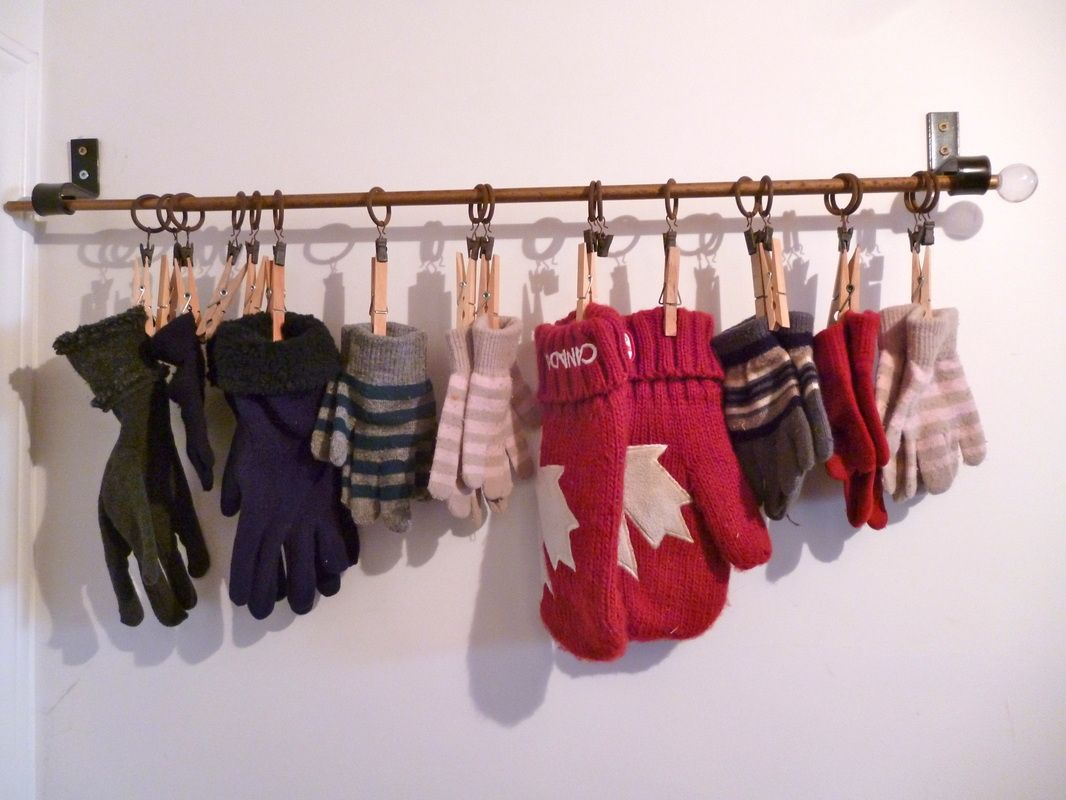 I use an old curtain rod and clothes pins to hang gloves. This would work with S-hooks and binder clips as well. It's easy to find a pair and this allows them to hang to dry. http://www.lifesaverorganizing.ca/blog.html