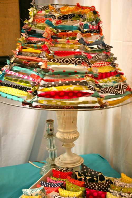 DIY Inspiration. Fabric Tied Lampshade. No tutorial but so easy. Either buy a lampshade frame or strip an existing one with metal struts. Then tie fabric. I did one like this using amber beads (pretty with the light on), but had to find a sturdy base to hold up the weight of the beads. Photograph from Color Issue here.
