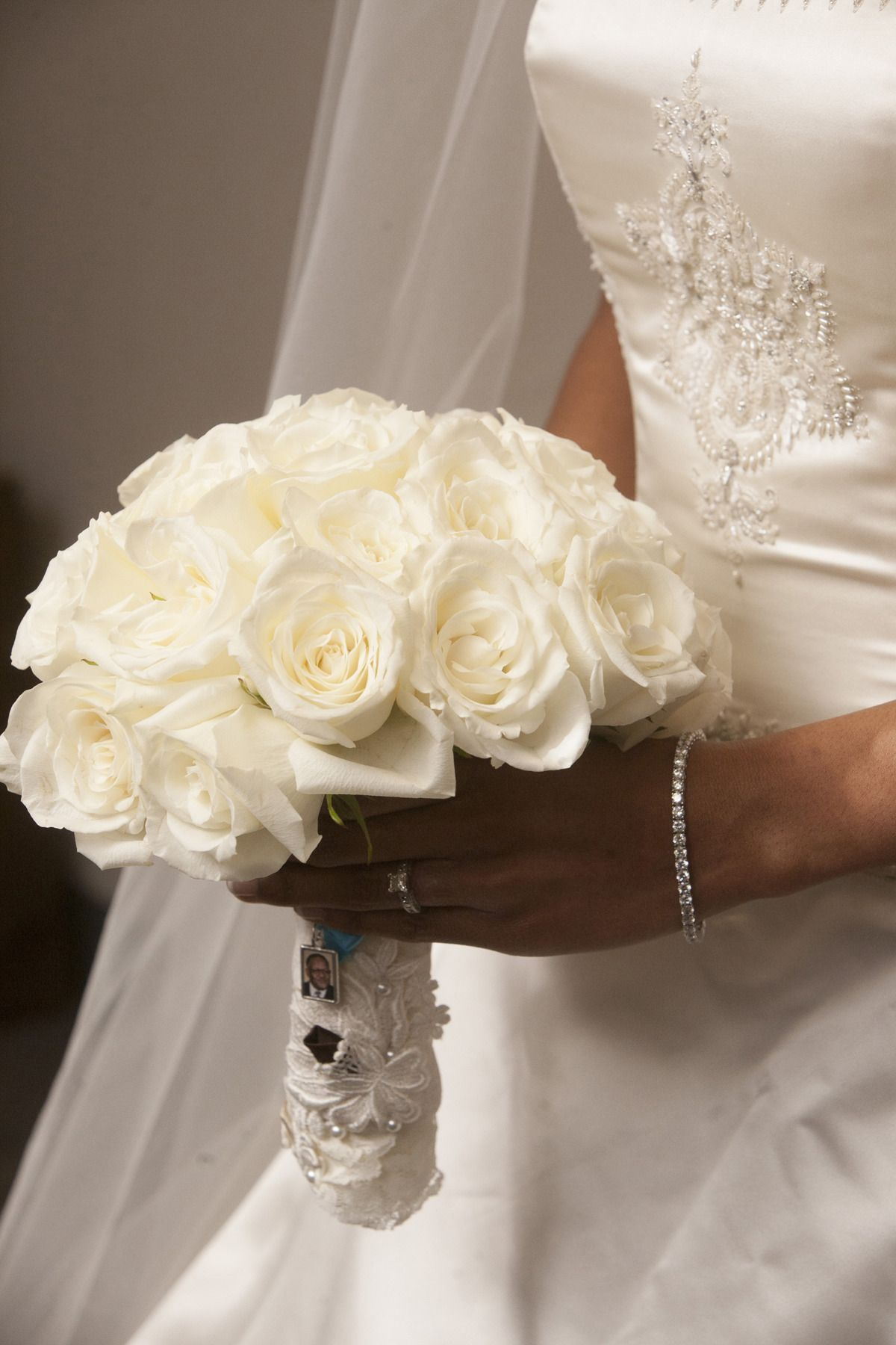 Creamy White Roses -- Timeless and Classic Wedding Bouquet. Nhan Photography | See more on SMP: http://www.StyleMePretty.com/southwest-weddings/2014/03/07/winter-wedding-at-the-crystal-ballroom/