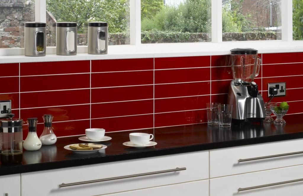 Kitchen Design Red Tiles white cabinetry.. black gloss bench top + red tiling / splash back