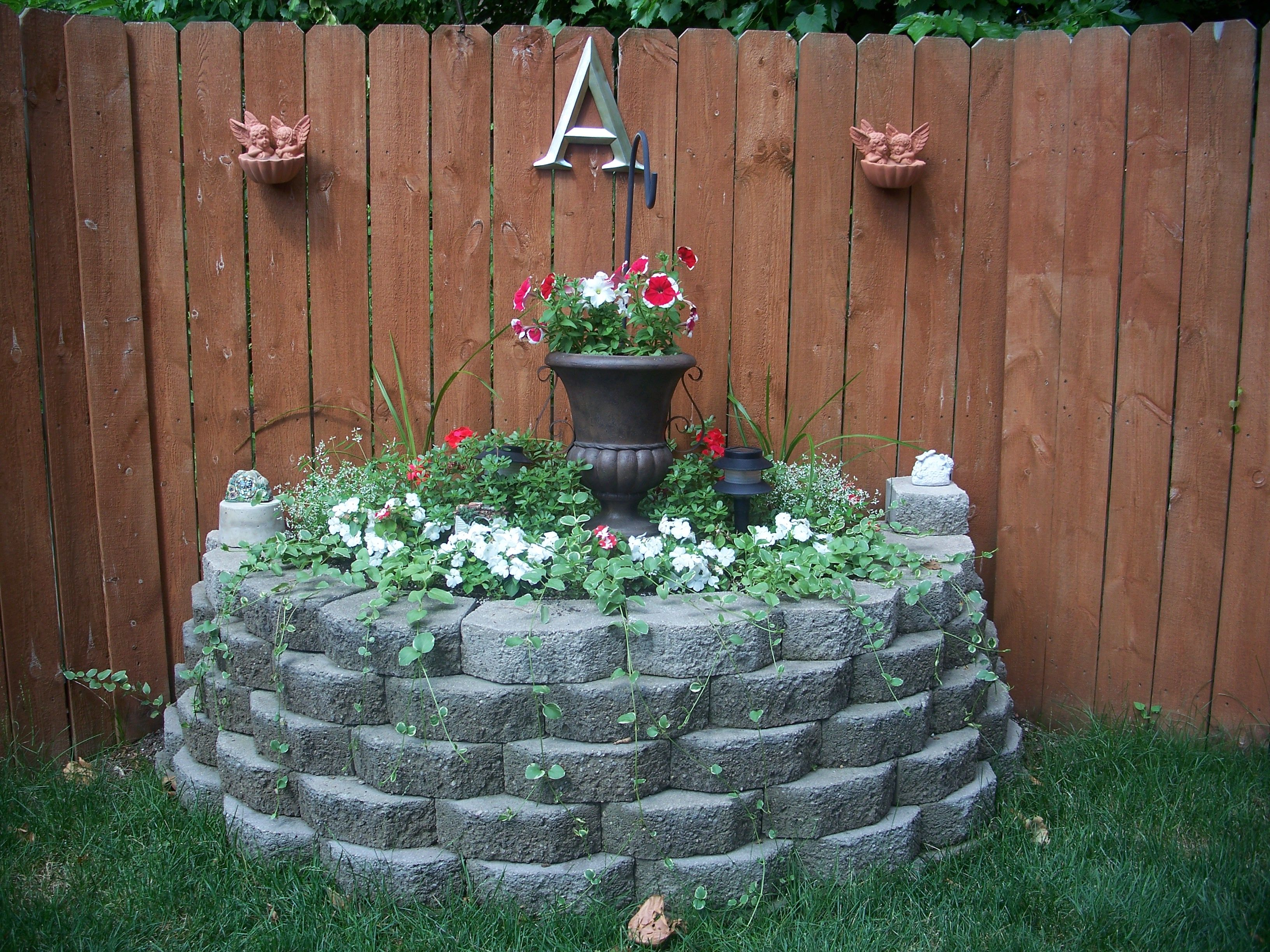 Corner flower bed Corner flower bed, Garden inspiration